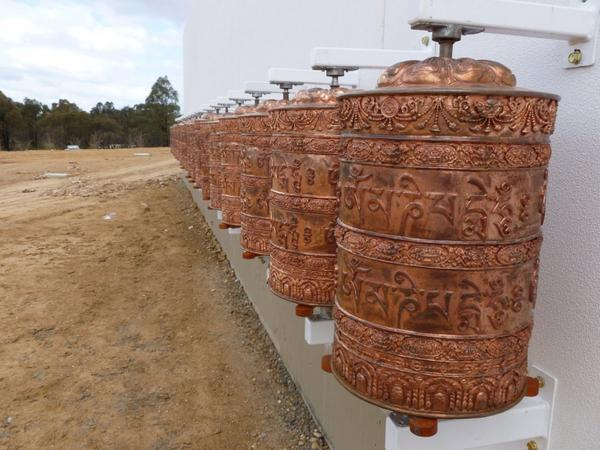The prayer wheels have been installed on the Great Stupa